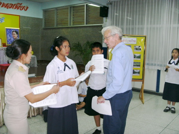 Shaun and Miss Chulapan rehearsing Thai students playing the old woman and Edward